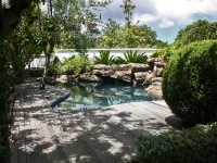 Rock embankment with waterfalls into swimming pool Cape Town