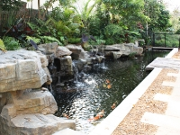 koi pond with rock embankment and waterfalls