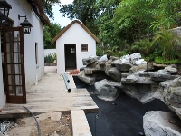 koi pond with rock embankment work in pr0gress